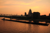 Barge carrying coal, sunset, Cincinnati, Ohio