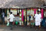 Come, buy my flowers, Pillayarpatti temple, Karaikudi, India