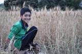 Nephew Mateen enjoing wheat cutting.