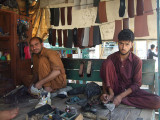 Pathans mending shoes in Samahni