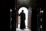 Monk in doorway
