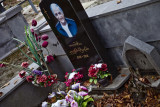 These photos on the tombstones are . . . unsettling.