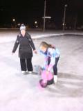 Kaitlyn helping Jordyn skate