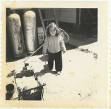 Linda Rich, her doll carriage and her propane tanks