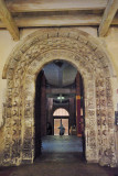 Norman doorway leading out to very brave C20th chapter house/reception centre