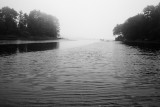 Boat and Float in Foggy Inlet