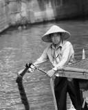Boatman in the Chineese Water Village of Zhujiajiao