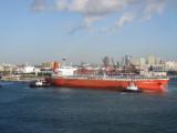 Tugs pulling a ship into port - sideways!