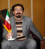 Nabavi Holding The Flag