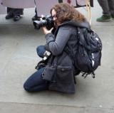 Squatting Photographer