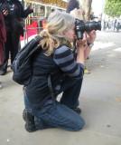 Squatting Blonde Photographer
