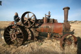 My wife  Patty  On Vintage Case Steam Tractor