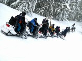 Snowmobile Touring Group Head Toward Sugarloaf.