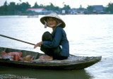 Boatwoman on a branch of the Mekong