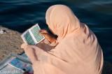 Woman reading the Koran on the Haji Ali Mosque causeway