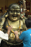 Rubbing Buddha's belly in Waterloo Street