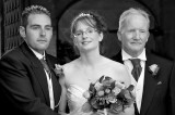 The Bride and Groom with the Bride's Dad in Black and White