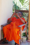 Buddhist monk checking messages