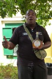 Larry holding a bottle of Curacao at the Chobolobo Liquor Factory