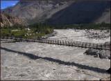 Khushhal Bridge over angry Indus river.jpg