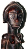 Fang female sculpture with metal disk eyes and helmet-style headdress, glossy patina, N Gabon. Height 32 cm.
