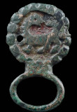 Baltic Viking Age buckle with the familiar backward-looking beast