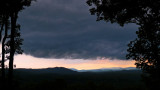 A SUMMER STORM APPROACHES THE MILLS RIVER VALLEY JUST BEFORE SUNSET  -  ISO 80