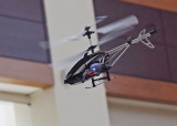 A RADIO CONTROLLED TOY HELICOPTER BEING DEMONSTRATED IN A CHARLOTTE, NORTH CAROLINA SHOPPING CENTER