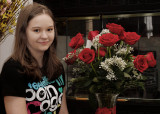 GRANDDAUGHTER WITH HER FLOWERS  -  TAKEN WITH A MANUAL FOCUS MINOLTA ROKKOR MD 50mm F/1.4 LEGACY LENS