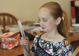 GRANDDAUGHTER KATIE, CHECKING HER STAGE MAKE-UP  -  TAKEN WITH A SONY 50mm F/1.8 E-MOUNT LENS