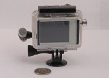 GO-PRO HERO2 (SPORTS EDITION), WITH LCD UNIT  -  INSTALLED  IN THE SKELETON CASE WITH A TRIPOD MOUNT