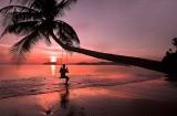 Kat swinging at sunset