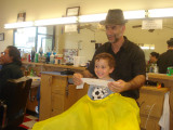 Schantigs first Hair cut sitting in a barber shop!