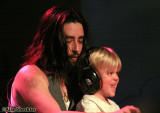 Jackie Greene brings 5-year-old local boy Quinn up onto the piano bench