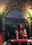Jackie Greene in front of new Sierra Nevada mural