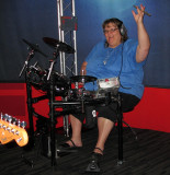 Donna shows off her drumming skills in the Roland Live make-your-own-music section of the Grammy Museum