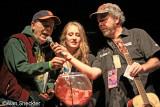 KZFR GM Rick Anderson, Miranda Austin, North Valley Production's Steve Schuman pick raffle winners and