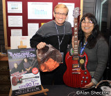 KZFR's Ray and Anna with guitar to be raffled