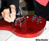 Ray Manzarek signs a guitar for KZFR radio raffle