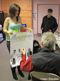 Ray Mazarek is presented with an old Doors poster to sign