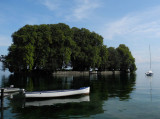 A lake isle, where peace comes dropping slow