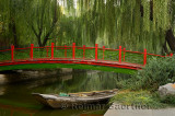 Old bridge over Changpu river with boat and willow trees in Beijing China