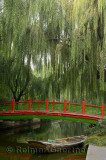 Old bridge and boat with willow trees in Changpu river park Beijing China