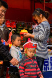 Chinese family shopping for hats for their two boys in Forbidden City Beijing China