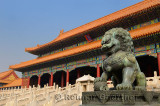Powerful bronze male lion at the Gate of Supreme Harmony in the Forbidden City Beijing China