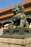 Bronze male lion symbol of power at the Gate of Supreme Harmony in the Forbidden City Beijing China