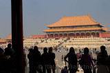 Silhouetted visitors viewing the Hall of Supreme Harmony from the Gate in the Forbidden City Beijing