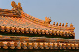 Ancient tiled roof with dragon figures in the Inner court of the Forbidden City Beijing China