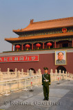 Peoples Armed Police guard with portrait of Mao Zedong at Tiananmen Gate of Heavenly Peace Beijing