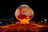 Globe and flower decorations at night National Day celebrations in Tiananmen Square with Great Hall of the People Beijing